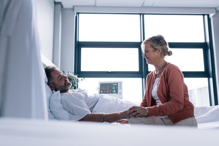 Woman visiting husband in hospital