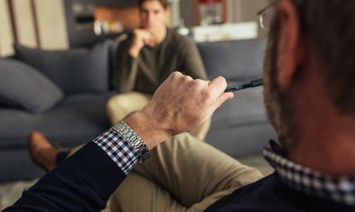 Psychotherapist understanding problems of a male patient