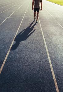 Sprinter walking on running track