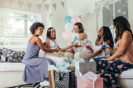 Female friends attending baby shower