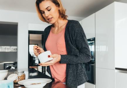 Woman preparing breakfast