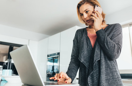 Woman managing office work from her home