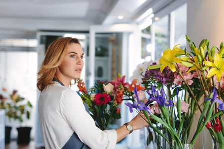 Woman working in retail flower shop