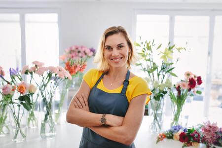 Positive flower shop owner