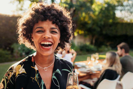 African woman enjoying at outdoors party