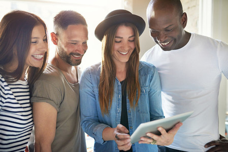 Girl sharing fun with friends using tablet