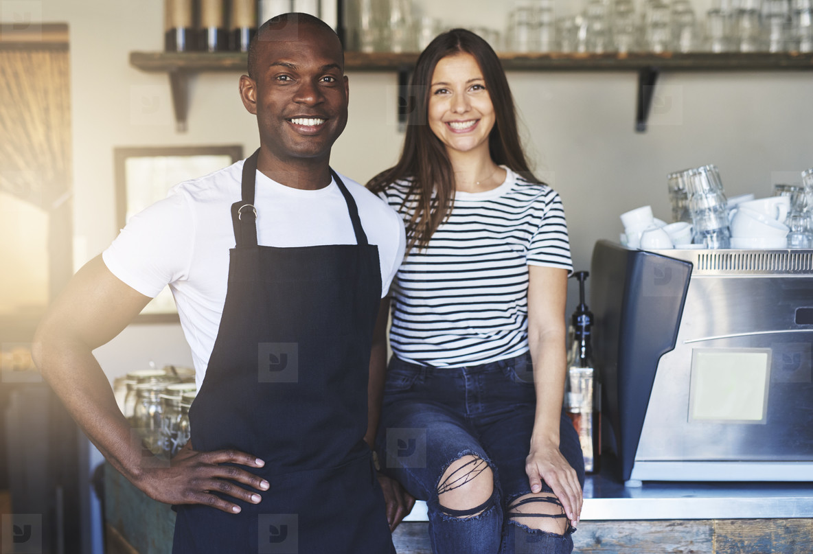 Happy young workers in restaurant
