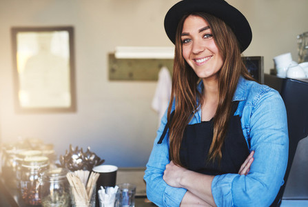 Female entrepreneur stands with arms crossed