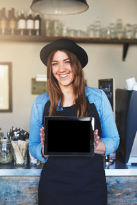 Female entrepreneur wearing black hat and apron