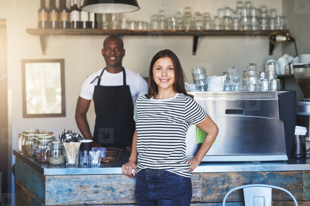 Smiling food service workers in coffee house