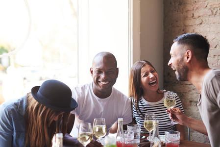 Joyful group of young adults drunk on wine