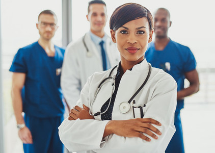 Black female doctor in front of team
