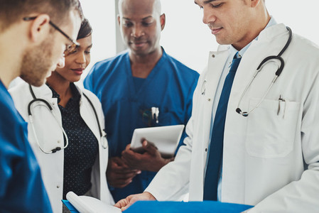 Team of multiracial doctors reading patient notes
