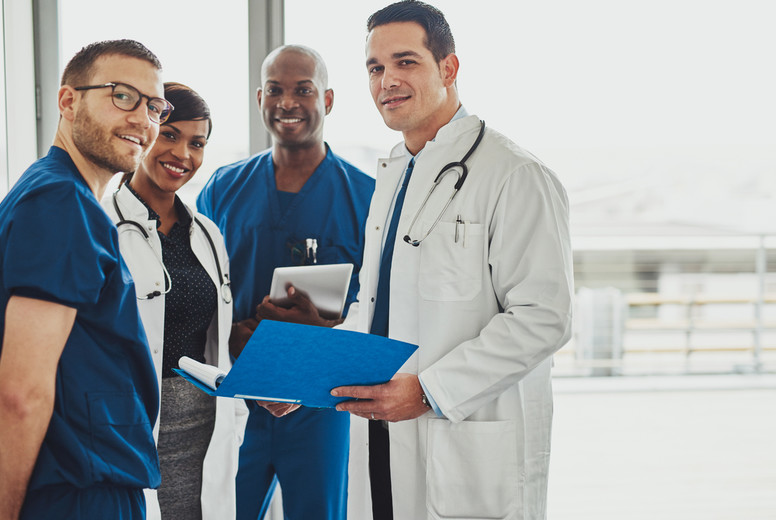 Doctors standing together looking relaxed