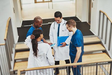 Confident team of doctors talking