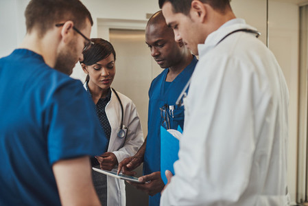 Diverse doctors having an emergency discussion