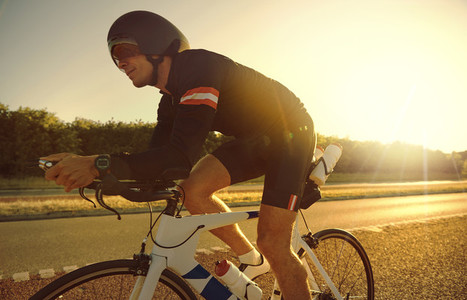 Bike rider moving on empty evening road