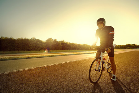 The resting cyclist standing in the evening