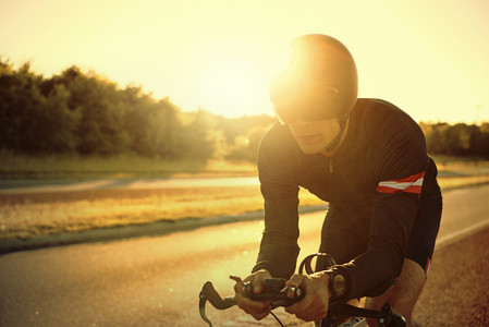 The cyclist riding bike in the evening