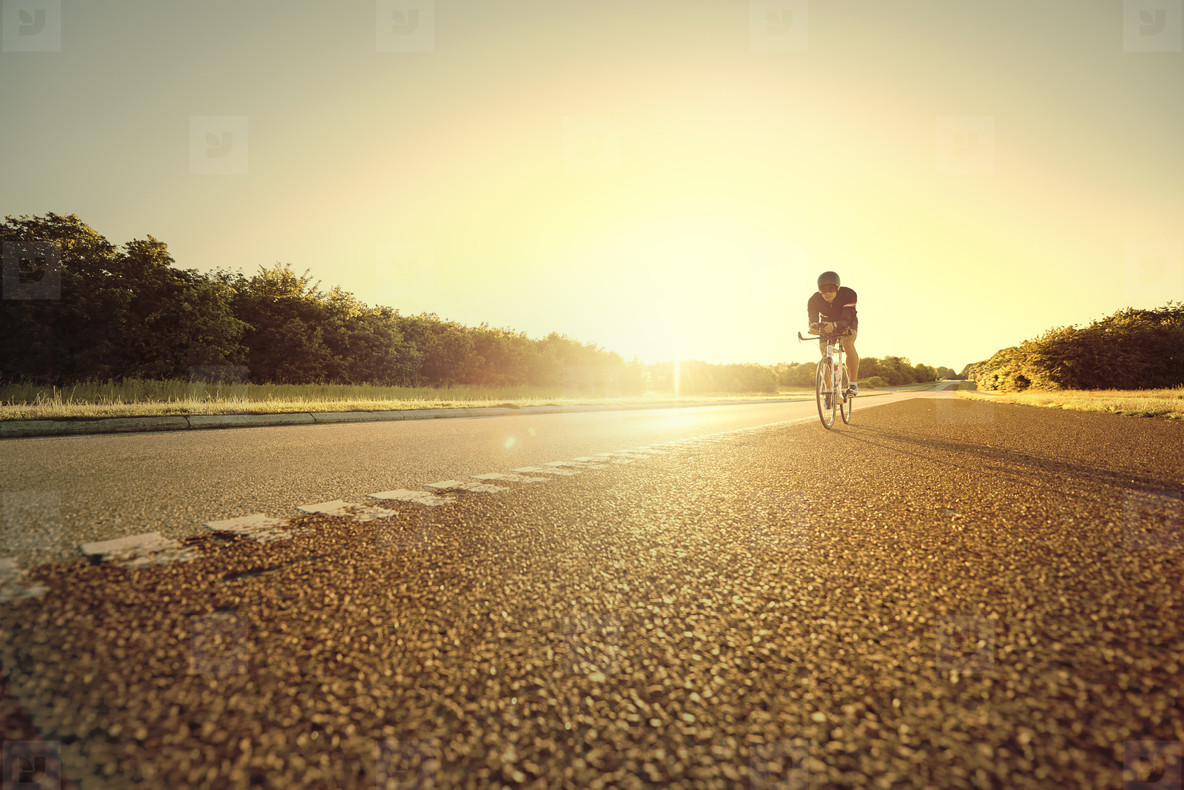 Person moving on bicycle on empty road