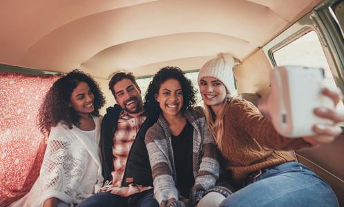 Friends making a selfie in the van