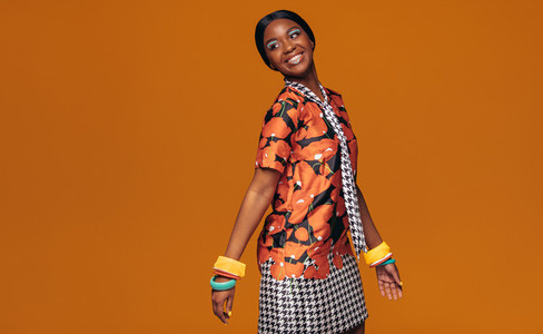 African fashion model on orange background