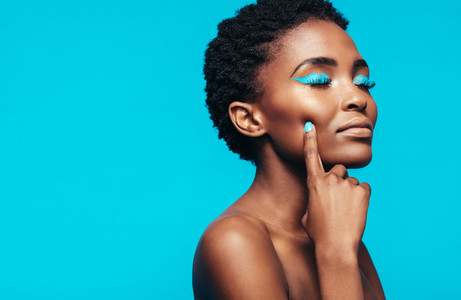 African female model with vibrant makeup