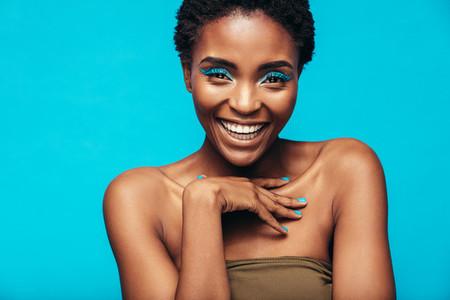 Beautiful african woman with vivid makeup