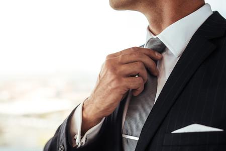 Businessman adjusting his look