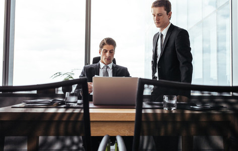 Business partners working together on laptop