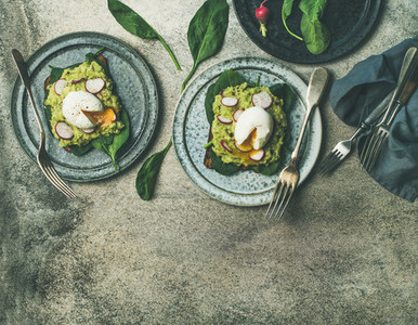 Healthy vegetarian breakfast flat lay  Avocado and poached egg toasts