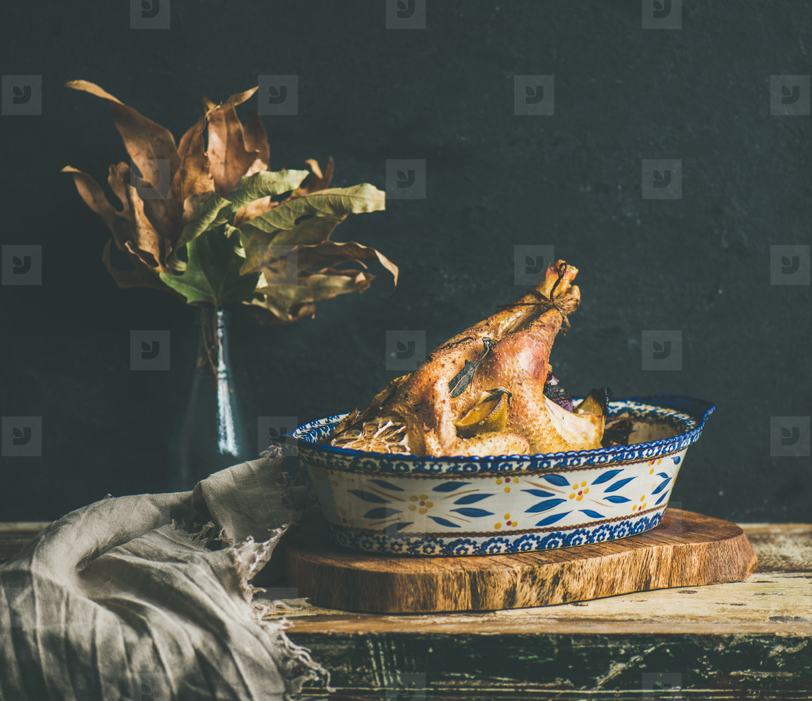 Roasted whole chicken for Christmas table  black wall background