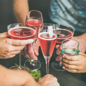 People having party  gathering  celebrating holiday with rose champaign