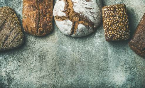 Top view of bread loaves over grey background  copy space