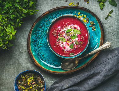 Spring beetroot soup with mint leaves and seeds  top view