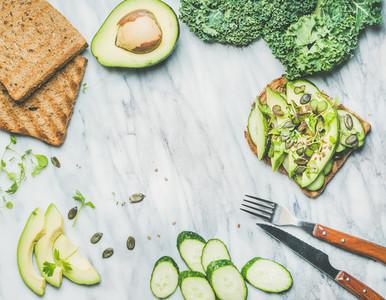 Breakfast with avocado  cucumber  kale  kress sprouts  pumpkin seeds sandwich