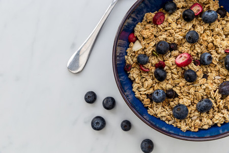 Breakfast cereal bowl with blueberries and fruit