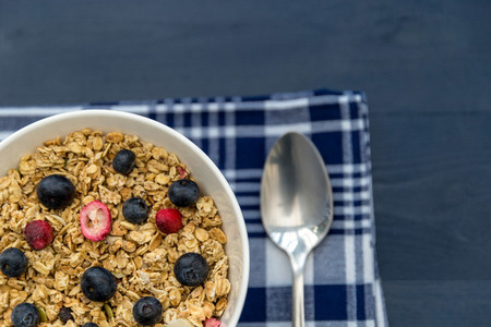 Healthy breakfast granola cereal with blueberries and spoon