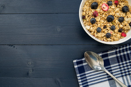 Healthy breakfast cereal bowl on table with copy space