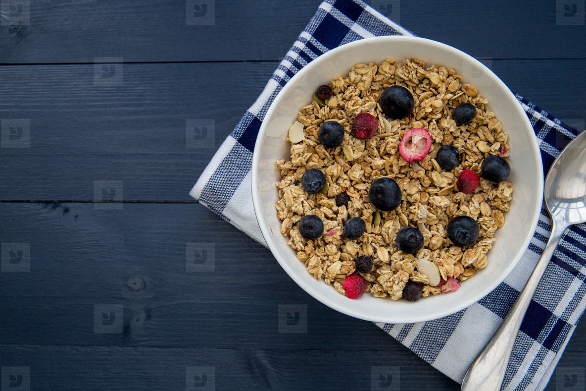 Healthy breakfast cereal bowl with spoon with copy space