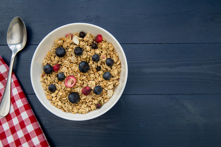 Healhy breakfast cereal bowl on wood table with copy space