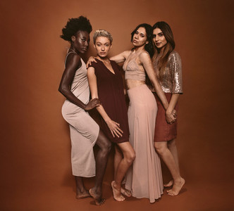Stylish diverse models posing in studio