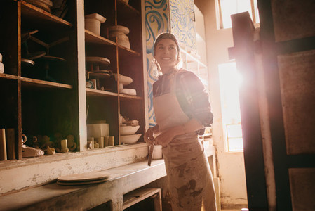 Female potter in pottery workshop