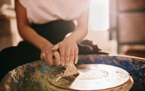 Female potter working on potters wheel
