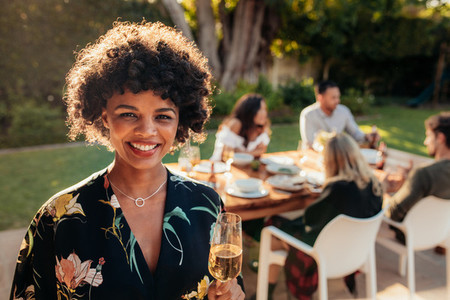 Smiling woman at outdoor party