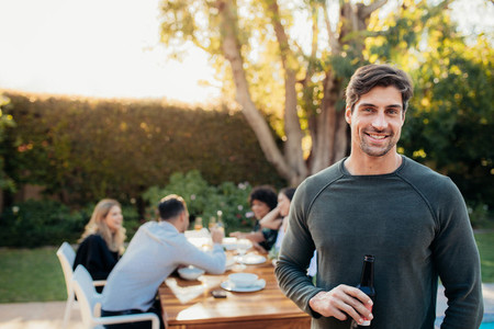 Man with beer at outdoor party