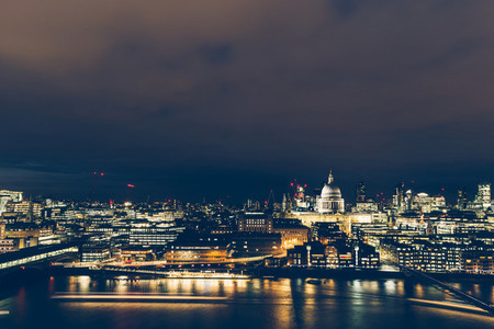 Elevated aerial view of modern London cityscape skyline at night