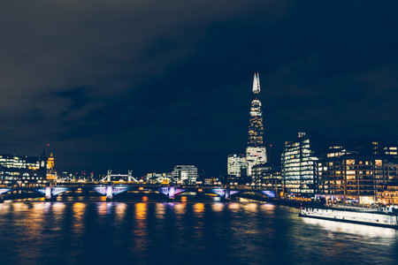 Long exposure shot at night on River Thames with shard building