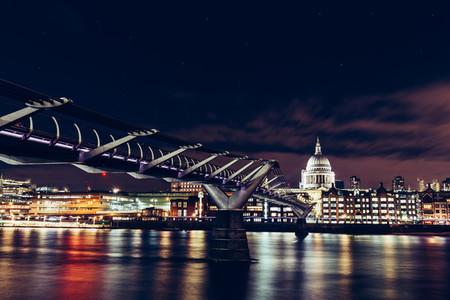 Long exposure of Millennium Bridge and London city skyline on Ri