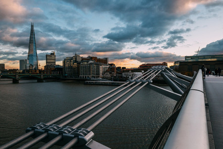 Modern London skyline on River Thames with Millennium Bridge and